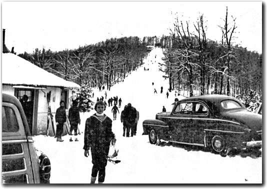 This photo shows the 550-foot ski slope at Chestnut Ridge, a small ski resort located near Coopers Rock State Forest in West Virginia from 1951 through 1973.  During the season this photo was taken, the ski slope was open for 40 days of skiing.